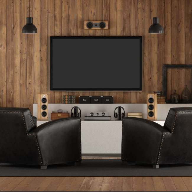 Home cinema in rustic stryle with black armchair, fireplace and wooden paneling - 3d rendering